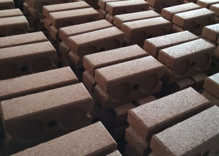 Compressed soil cement brick stock